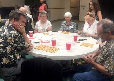 Eye-Das members playing Bingo and enjoying a potluck dinner