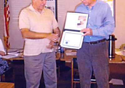 Howard Hawkins presenting the Award to Frank Salamone