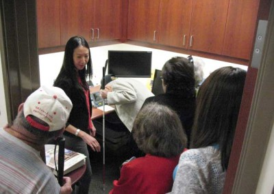 Dr. Linda Pang with members at Western University of Health Sciences Eye Care Center